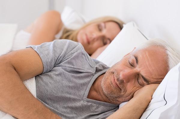 Elderly man & woman sleeping